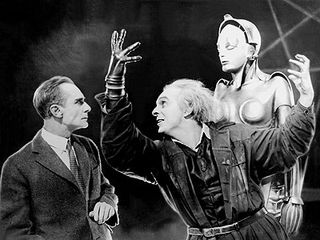 1930s film Metropolis which features an Occult ritual Summoning of Babalon the Scarlet Woman TIN MAN GLOVE,BREASTS and a Pentagram